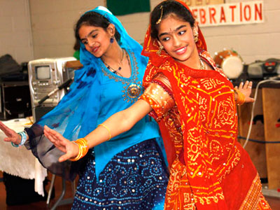 Heli Gandi, left, and Tanvi Tailor, right, performed bollywood dance in the celebrations of Holi festival held at the Scarborough Village Community Centre.