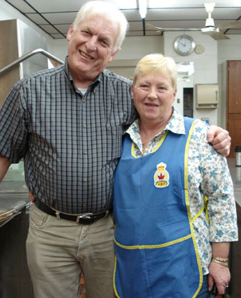 Jim Gyselinck, President of Branch 258 of the Royal Canadian Legion, and his wife Linda cook breakfast for the Sunday brunch.