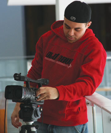 Director Charlie DiVito adjusts his camera while filming a scene for his horror movie at Centennial's Ellesmere campus.