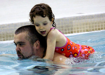 Swimming at Sir Oliver Mowat Collegiate with his daughter Avereigh, Lenard Smith says pools shouldn't be shut down.