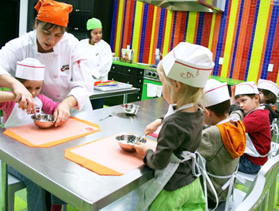 Children learn to make banana pudding during a class at the Rising Chefs Culinary Centre on Rylander Boulevard.