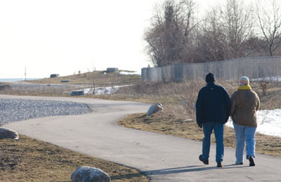 The snow has melted allowing this couple to walk down phase one of the Port Union waterfront development.
