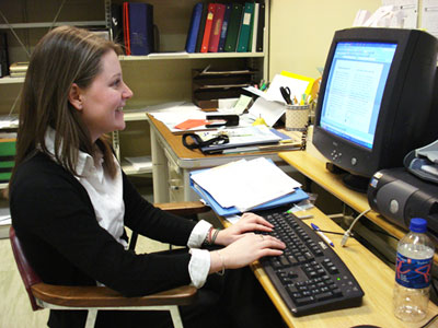Whitney Jackman, a Queen's University student, is spearheading the EcoSchool initiative in preparation for Earth Hour.