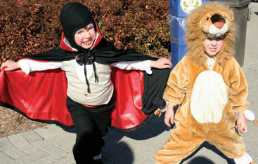 ack, 5, the friendly vampire and Finn, 4, a lion, get ready for fun at the Toronto Metropolitan's Boo at the Zoo on Saturday.