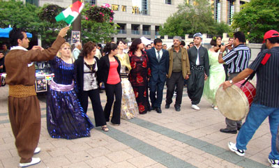 Visitors participate in Kurdish dancing, which took place at Mel Lastman Square.