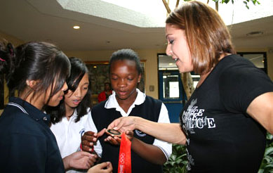 Lopes-Schliep shows her bronze to students at Pope John Paul II Catholic Secondary School.