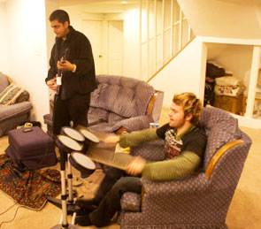 Mihir Sircar and his friend, Phillip Smalley, engage in a raucous session of Rock Band.