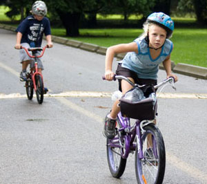 Katie Russell, 9, battles wet roads and ambitious competition on her way to completing 10 km on her bike. She is one of the members of 'Team Owen' that raised $4,000 for their neighbour with cancer, Owen McNeil.