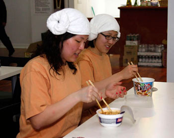 Dong-Young Lim, front, and Ji-Ae Hwong enjoy eating noodle at Korean-style