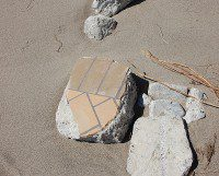 Pieces of concrete and tile litter the beach. (Selena Mann/Toronto Observer)
