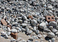 Rocks, concrete, brick and rubble, dumped by the TRCA and City of Toronto, cover the naturally occurring sand. (Selena Mann/Toronto Observer)
