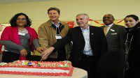TDSB trustee Nadia Bello, MP John McKay, Councillor Ron Moeser and Newcomer Services project administrator Bantu Mutenka celebrate the opening of the new Kingston-Galloway centre for young newcomers.
